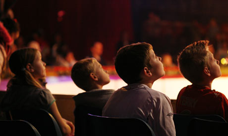 A young audience enjoys a trip to the theatre. Credit: David Levene for the Guardian